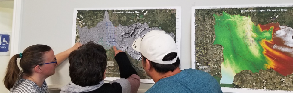 Researchers and Community looking at maps of flooding events